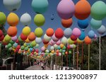 colored balloons hanging on a... | Shutterstock . vector #1213900897