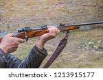 men pulling the trigger of... | Shutterstock . vector #1213915177