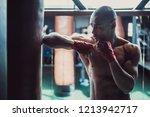 afro american boxer  his hands... | Shutterstock . vector #1213942717