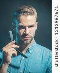 portrait of man shaving with... | Shutterstock . vector #1213967671