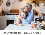 happy grandmother is hugging... | Shutterstock . vector #1213977067