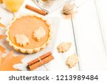 pumpkin pie with cinnamon and... | Shutterstock . vector #1213989484