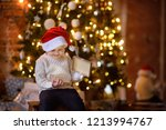 cute little boy wearing santa... | Shutterstock . vector #1213994767
