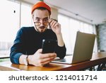 shocked caucasian hipster guy... | Shutterstock . vector #1214011714