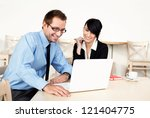 Two happy business people meeting - stock photo