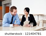 Meeting of two happy business people - stock photo