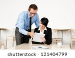 Two happy business people working with tablet - stock photo