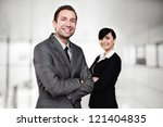 Two business people standing - stock photo