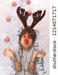 cute kid with reindeer antlers... | Shutterstock . vector #1214071717