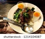 rice pork leg is on a white... | Shutterstock . vector #1214104087