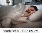 asian teen girl lying on bed in ...   Shutterstock . vector #1214122291