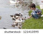 Children Feeding Ducks At The...