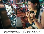 asian woman gambling in casino...