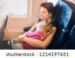 mom with kid sleeping in... | Shutterstock . vector #1214197651