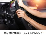 hands of driver in a car | Shutterstock . vector #1214242027
