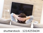 young woman watching tv in the... | Shutterstock . vector #1214253634