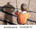 a young boy is sitting on a... | Shutterstock . vector #121428757