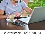 young guy freelancer working on ... | Shutterstock . vector #1214298781