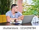 young guy freelancer working on ... | Shutterstock . vector #1214298784