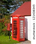 Iconic Red Lamp Box post box and telephone kiosk in Scotland - stock photo