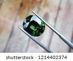natural unheated green sapphire ... | Shutterstock . vector #1214402374