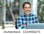 portrait of happy mature man... | Shutterstock . vector #1214406271