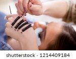 young woman getting eyelash... | Shutterstock . vector #1214409184