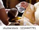 infant baptism. water is poured ...   Shutterstock . vector #1214447791