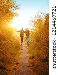 two happy girls run away into... | Shutterstock . vector #1214469721