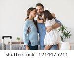 diverse family standing hugging ... | Shutterstock . vector #1214475211