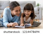 attractive mother with little... | Shutterstock . vector #1214478694
