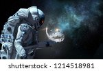 spaceman and his mission. mixed ... | Shutterstock . vector #1214518981