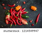 mix of hot peppers on dark... | Shutterstock . vector #1214549947