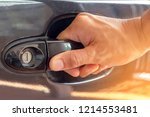 hand on handle close up of man... | Shutterstock . vector #1214553481
