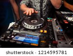 dj mixes the track in the... | Shutterstock . vector #1214595781