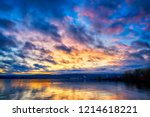 dramatic clouds over lake... | Shutterstock . vector #1214618221