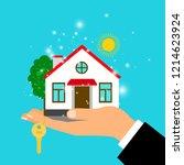 man hand holding house building ...   Shutterstock . vector #1214623924