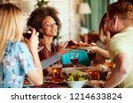 friends having dinner at home.... | Shutterstock . vector #1214633824