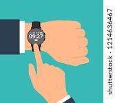 smart watch on the hand of... | Shutterstock .eps vector #1214636467