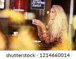 blond woman on lunch break sit... | Shutterstock . vector #1214660014