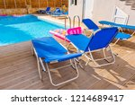 sunbeds by a swimming pool in...   Shutterstock . vector #1214689417