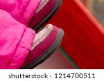 small red leather baby shoes on ... | Shutterstock . vector #1214700511