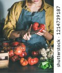 woman in linen apron cutting... | Shutterstock . vector #1214739187