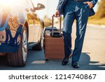 traveling businessman with his... | Shutterstock . vector #1214740867