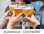group of friends drinking beer  ... | Shutterstock . vector #1214760307
