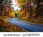 winding country road in autumn... | Shutterstock . vector #1214859454
