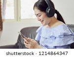 women are listening to music... | Shutterstock . vector #1214864347