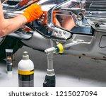 car polish wax worker hands... | Shutterstock . vector #1215027094