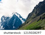snowy mountain top behind rocky ... | Shutterstock . vector #1215028297