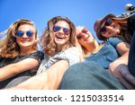 group of happy smiling carefree ... | Shutterstock . vector #1215033514